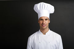 Chef cook against dark background Royalty Free Stock Images