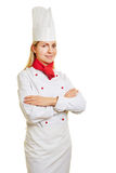 Chef cook in apprenticeship in workwear Royalty Free Stock Images