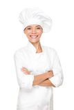 Chef, cook or baker woman. Happy proud portrait of female in chef uniform and chef hat isolated on white background. Asian Caucasian woman model Royalty Free Stock Photography