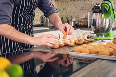 Chef cook baking sweets on a modern kitchen Stock Images