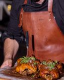 Chef cook brings meat from the barbecue Stock Photo