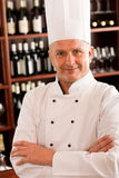 Chef cook confident professional posing restaurant Stock Image