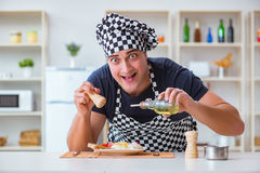 The chef cook cooking a meal breakfast dinner in the kitchen Royalty Free Stock Photo