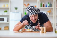 The chef cook cooking a meal breakfast dinner in the kitchen Royalty Free Stock Images