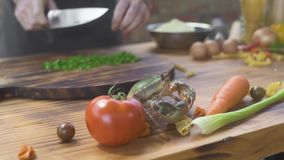 Chef cook cutting ingredient for preparing seafood in italian restaurant. Cook catching live crab for cooking in seafood. Restaurant. Fresh ingredient stock video footage