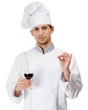 Chef cook hands goblet with wine Royalty Free Stock Photos