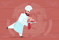 Chef Cook Holding Dessert Dish Smiling Cartoon Chief In White Restaurant Uniform Over Wooden Textured Background Royalty Free Stock Photography