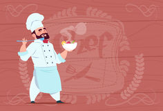 Chef Cook Holding Plate With Hot Soup Smiling Cartoon Chief In White Restaurant Uniform Over Wooden Textured Background. Flat Vector Illustration Stock Photos