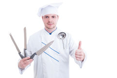 Chef or cook holding professional knives and showing like gestur Stock Photo