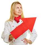 Chef cook holding red arrow pointing up Stock Image