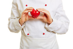 Chef cook holding red heart Stock Photos