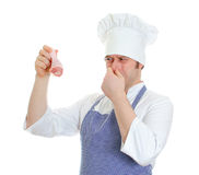 Chef cook holding rotten chicken leg. Royalty Free Stock Images