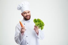Chef cook holding salad and carrot Royalty Free Stock Photo