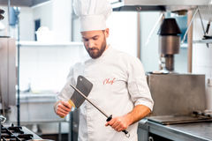 Chef cook at the kitchen Royalty Free Stock Photos