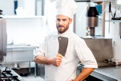 Chef cook at the kitchen Stock Images