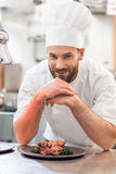 Chef cook at the kitchen Royalty Free Stock Image