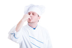 Chef or cook making delicious gesture by kissing fingers Stock Photography
