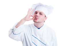 Chef or cook making tasty gesture by kissing fingers Stock Photo
