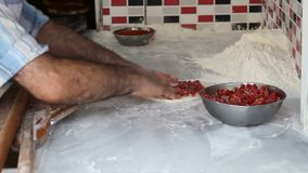 Chef cook man making pita with meat Turkish pizza stock video footage