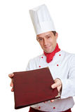 Chef cook offering menu card. Happy chef cook offering a menu card royalty free stock photos