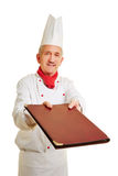 Chef cook offering menu card Stock Photography