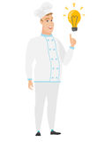 Chef cook pointing at bright idea light bulb. Stock Photography