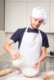 Chef cook pours milk in a glass Royalty Free Stock Photos