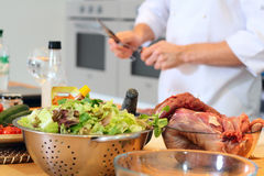 Chef cook preparing for cooking. Meat and salad waiting to be prepared Stock Photo