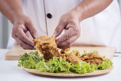 Chef cook preparing fried chicken Royalty Free Stock Images