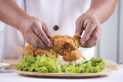 Chef cook preparing fried chicken Royalty Free Stock Photos