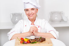 Chef-cook presenting meals Stock Photography