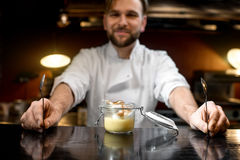 Chef cook serving lemon dessert Royalty Free Stock Image