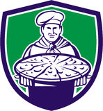 Chef Cook Serving Pizza Crest Retro. Illustration of a chef, cook baker serving pizza platter facing front set inside shield crest on isolated background done in Royalty Free Stock Photos