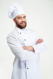 Chef cook standing with arms folded. Portrait of a happy male chef cook standing with arms folded isolated on a white background Royalty Free Stock Image