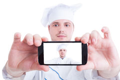 Chef or cook taking selfie with back phone camera Royalty Free Stock Image