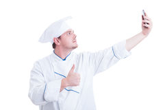 Chef or cook taking selfie with phone camera showing like Stock Image