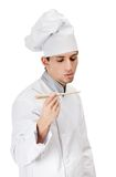 Chef cook tastes the prepared dish Royalty Free Stock Photography