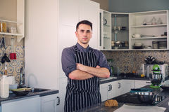 Chef cook working on a modern kitchen at home Stock Images