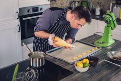 Chef cook working on a modern kitchen at home Stock Image