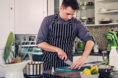 Chef cook working on a modern kitchen at home Royalty Free Stock Photo