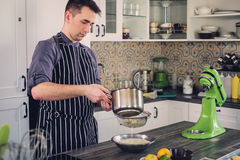 Chef cook working on a modern kitchen at home Royalty Free Stock Photography