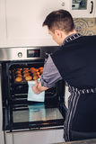 Chef cook working on a modern kitchen at home Royalty Free Stock Image