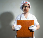 Chef with the cookbook Stock Images