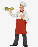 Chef with cooked fish. Smiling chef with cooked fish and vegetables Stock Photos