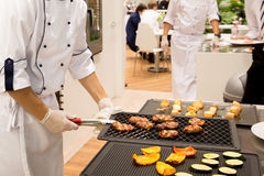 Chef cooked meat steaks on the grill. In the restaurant Royalty Free Stock Photography