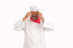 Chef holding cookies over eyes Stock Photo
