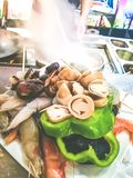 Chef cooking at Asian food restaurant. Seafood and vegetables dish ready to be cooked royalty free stock photography