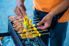 Chef cooking at barbecue dinner buffet. Barbecue Grill Street Food in Thailand stock photography
