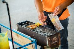 Chef cooking at barbecue dinner buffet. Barbecue Grill Street Food in Thailand stock photo