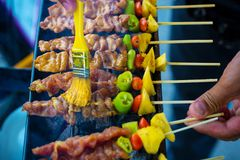 Chef cooking at barbecue dinner buffet. Barbecue Grill Street Food in Thailand royalty free stock images